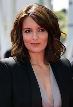 Tina Fey Lookbook: Tina Fey wearing Medium Wavy Cut (10 of 14). Tina's hair is styled down with large sexy waves that look great with her top and bold shouldered blazer.