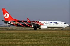 Turkish Airlines Boeing 737-800 TC-JFV in special Manchester United livery at Schiphol Int. Airport, Amsterdam.