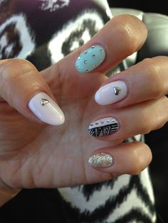 Gel nail design with hearts and rhinestone crystals