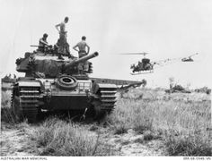 Members of the Armoured Regiment, Royal Australian Armoured Corps (RAAC), on the move with their Centurion tanks from Nui Dat to Fire Support Base (FSB) Coral in Bien Hoa Province watch as a Sioux helicopter prepares to land at right. Vietnam War Photos, Anzac Day, South Vietnam, Battle Tank, World Of Tanks, My War, Military Equipment, Armored Vehicles, Usmc