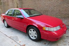 For Sale: 1995 Ford Taurus SHO (red, 3.2L DOHC V6, 4-speed auto, 12K miles) Ford Taurus Sho, Air Conditioning System, Cruise Control, Classic Cars Online, Alloy Wheel, Cadillac, Yamaha, Beige, Leather