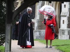 The Queen stole the show in her vibrant red ensemble as she left St Mary Magdalene Church ...