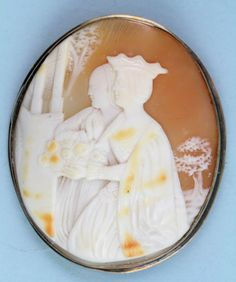 """19th century Elizabethan style cameo brooch with gold, inscribed 'H.E. Wilcox', 2 1/8"""" x 1 7/8""""."""
