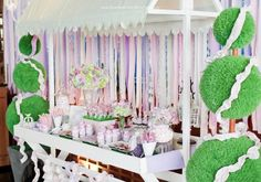 wow! I want a sweet trolley! arrggh! Love the lilacs and the green and topiary!  394759_408783122500819_70342799_n_600x421