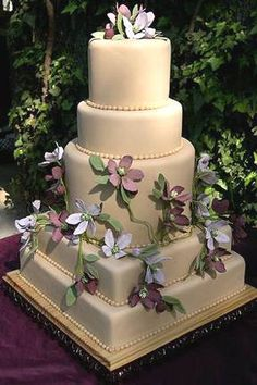 square and round cake with violet flowers