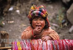 Young Quechua girl in traditional dress , Willoq , near Ollantaytambo , Peru