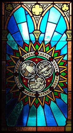 Petropolis_Holy_Trinity_circles_symbol_stained-glass_window.jpg