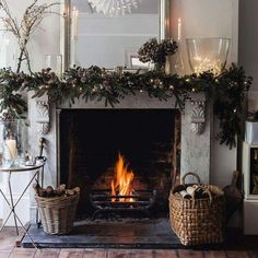 LOVELY LOVELY mantle - but with candles in hurricanes for safety and more red / berries through the garland