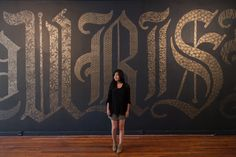adding different patterns to gold blackletter on a huge wall!
