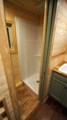 Pocket door between bath and kitchen to save space.  valley-view-tiny-house-co-shenandoah-160-sf-tiny-house-on-wheels-0013