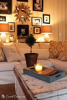 We love this cozy seating area with white wood walls and a comfy white sofa