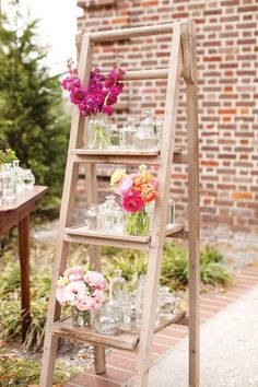 Flower display on a vintage ladder at the entrance to the wedding ceremony