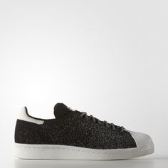 The adidas Superstar shoe debuted in 1970 and quickly lived up to its name as NBA players league-wide laced into the now-famous shell-toe sneaker. These men's shoes update the vintage style with a modern adidas Primeknit upper and glow-in-the-dark details.