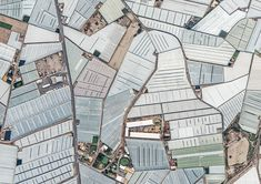 The area in southern Spain known as mar del plástico is a landscape dominated by vast stretches of greenhouse farms. From the ground, it looks like nothing but roads winding through a maze of covered crops. But when seen from the air in photographer Bernhard Lang's images, things look a bit more surreal.