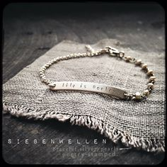 """life is poetry""....   s i e b e n w e l l e n   bangle. sterling-silver,  poetry stamped, peals."
