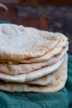 This Easy Pita Bread Recipe is going to change your life! You will never go back to store bought after this.  The Mediterranean Dish #pitabread #homemadepitabread
