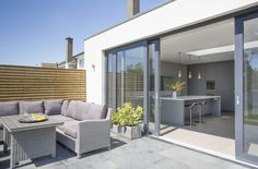 Ideas Grey Patio Doors Gardens For 2019 House Extension Plans, House Extension Design, House Design, Bungalow Exterior, Bungalow Renovation, Grey Window Frames, Modern Patio Doors, Rendered Houses, Orangery Extension