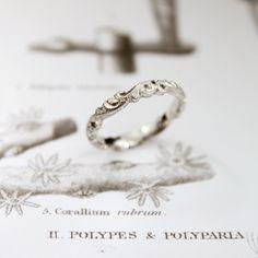 Hand engraved platinum wedding ring Rust Jewellery