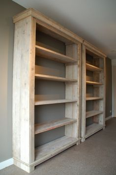 This tall bookcase was custom-built in our shop. It features stained planks on the back, adjustab How To Make Bookshelves, Homemade Bookshelves, Floor To Ceiling Bookshelves, Bookshelf Diy, Diy Wood Projects, Home Projects, Woodworking Projects, Wooden Wardrobe, Diy Holz