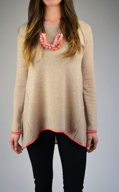 Cozy Swing Sweater is a spring must-have! This sweater has a crew neckline, high-low hemline, fitted sleeves and a contrast tipping color.