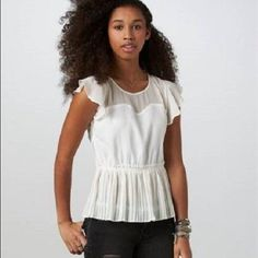 AE white peplum top Sheer, flowy material makes this top stylish as well as comfy. Around the shoulders is mesh but the whole top is pretty sheer. Exposed zipper down the back, pleated bottom. American Eagle Outfitters Tops