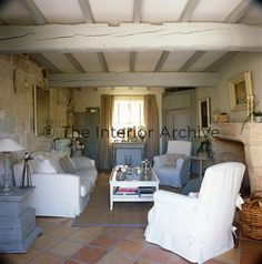 Avignon - A comfortable country sitting room with grey painted beams across the ceiling and a stone fireplace. Cottage Living Rooms, Cottage Interiors, Living Spaces, Salons Cottage, Painted Beams, Sweet Home, Country Interior, French Farmhouse, French Cottage