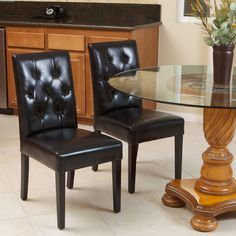 Give your decor a luxurious finish with these stunning black leather dining chairs. These chairs have sturdy frames and bonded leather upholstery. The tufted backs add style and comfort, and they are a chic way to add seating to your dining room. Bar Furniture, Furniture Deals, Dining Room Furniture, Room Chairs, Dining Room Bar, Dining Chair Set, Dining Tables, Black Leather Dining Chairs, Parsons Chairs