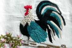 kitchen towel with hand embroidered rooster. via Etsy.