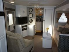 Camper Travel Trailer RV remodel, My parents gave us their old camper....now they want it back!, Living Room After, Other Spaces Design