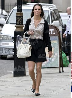 Casual skirt, blouse, and sweater.