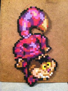 Cheshire cat from Alice in Wonderland perler beads by Kat Jones