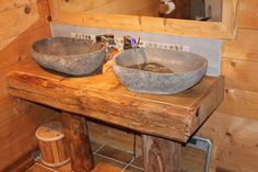 Rustic ski chalet bathroom in the French Alps. Lovely stone sinks with LED temperature sensitive taps
