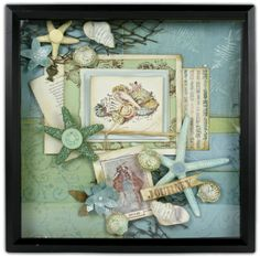 Beachy shadow box.  The ones I remember from our honeymoon condo were prettier, but had this same basic concept: postcards, sand, shells, etc.