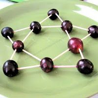 Toothpick art to practice fine motor skills. Marshmallows or other objects could be used instead of grapes.