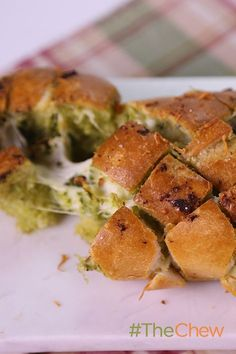 So easy, so cheesy! You have to try this scrumptious Cheesy Pull-Apart Pesto Bread by Carla Hall at your next party!