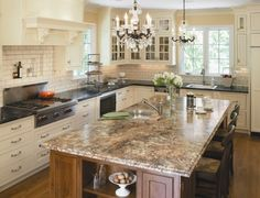 This is it!  Antique white outer cabinets with black granite and walnut island with lighter granite.  My future kitchen.