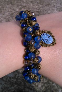 blue and bronze cluster bracelet with blue cameo pendant