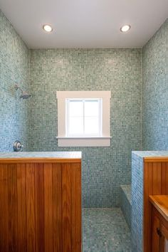 The bathroom shower uses certified recycled tile, a dual flush toilet and floors, cabinets and wainscoting made from reclaimed longleaf pine.