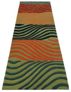 """A custom hand tufted pure wool rug in watermelon red, sea green, deep wedgewood blue, soft olive green, dark salmon and pale orange. It has a pile depth of 12-14mm. Created using the """"Fizzer"""" design. #CustomRugRoom"""