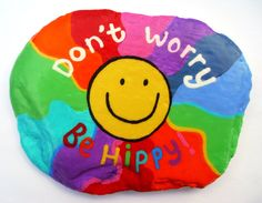 Dont worry, Be hippy... A super smiley, psychedelic rainbow pebble!  Hand painted pebble using acrylic paints. Fully varnished and weather proof! Can be