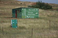 I love this picture on so many levels. Rural South Africa and this person used geographical motorist signs to construct the walls of his home. It reminds me of a South African saying 'Oos, wes, tuis bes' (East, west, home best) Funny Road Signs, South Afrika, Thing 1, Out Of Africa, My Land, Home Signs, Pretoria, Cape Town, World