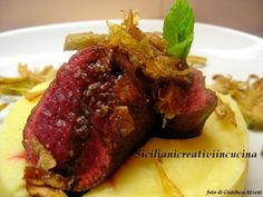 Cuore di filetto con carciofi e purè di patate