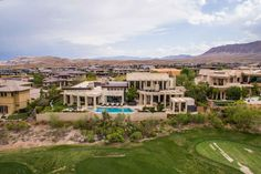 The backyard of this home is extraordinary, perched high above the fairway, sweeping views can be enjoyed in every direction. Including multiple fire pits, a full outdoor kitchen with a built-in television, a serene infinity edge pool and a putting green, the outdoor living spaces are sure to please.