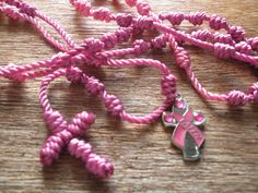 Solid PINK Knotted Cord Rosaries with Pink Ribbon FAITH or HOPE Cross Charm by georgiegirl83 on Etsy https://www.etsy.com/listing/94961030/solid-pink-knotted-cord-rosaries-with