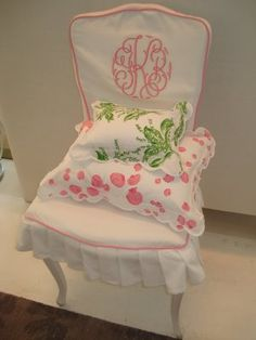 Porthault chair with pink seashell and Lily of the Valley shams, as seen at the former Porthault boutique in Dallas.