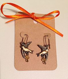 A personal favorite from my Etsy shop https://www.etsy.com/listing/231375988/antique-bronze-tone-dove-charm-earrings