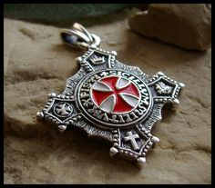 The Red Cross stands for the symbol of the Templars, but also for St. George (and the English National flag)
