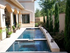 This charming lap pool and spa by Endless Pools makes the most of a small patio and offers attractive architectural details over which a row of pencil cedars stands guard. Small Inground Pool, Small Backyard Pools, Swimming Pools Backyard, Lap Pools, Small Patio, Indoor Pools, Pool Landscaping, Pool Spa, Spa Spa