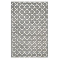 Hand-tufted wool rug with a quatrefoil motif in dark gray and ivory.   Product: RugConstruction Material: WoolColor: Dark gray and ivoryFeatures: Hand-tuftedNote: Please be aware that actual colors may vary from those shown on your screen. Accent rugs may also not show the entire pattern that the corresponding area rugs have.Cleaning and Care: Professional cleaning recommended
