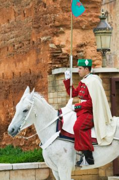 Morocco, Rabat, guard on horse  outside the Mausoleum of Mohammed V.